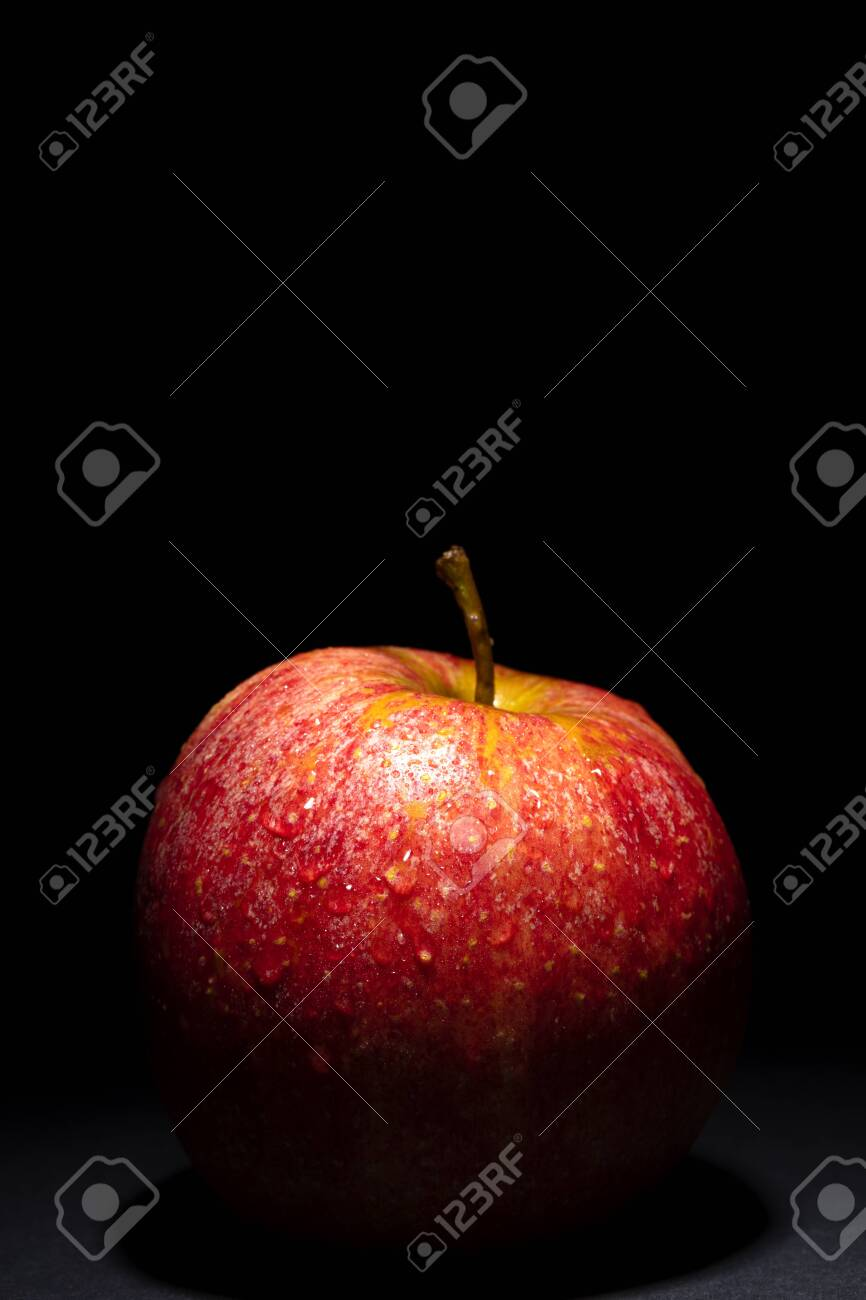 red apple with drops of water on black background, image conveys freshness, free space above for text - 123523743