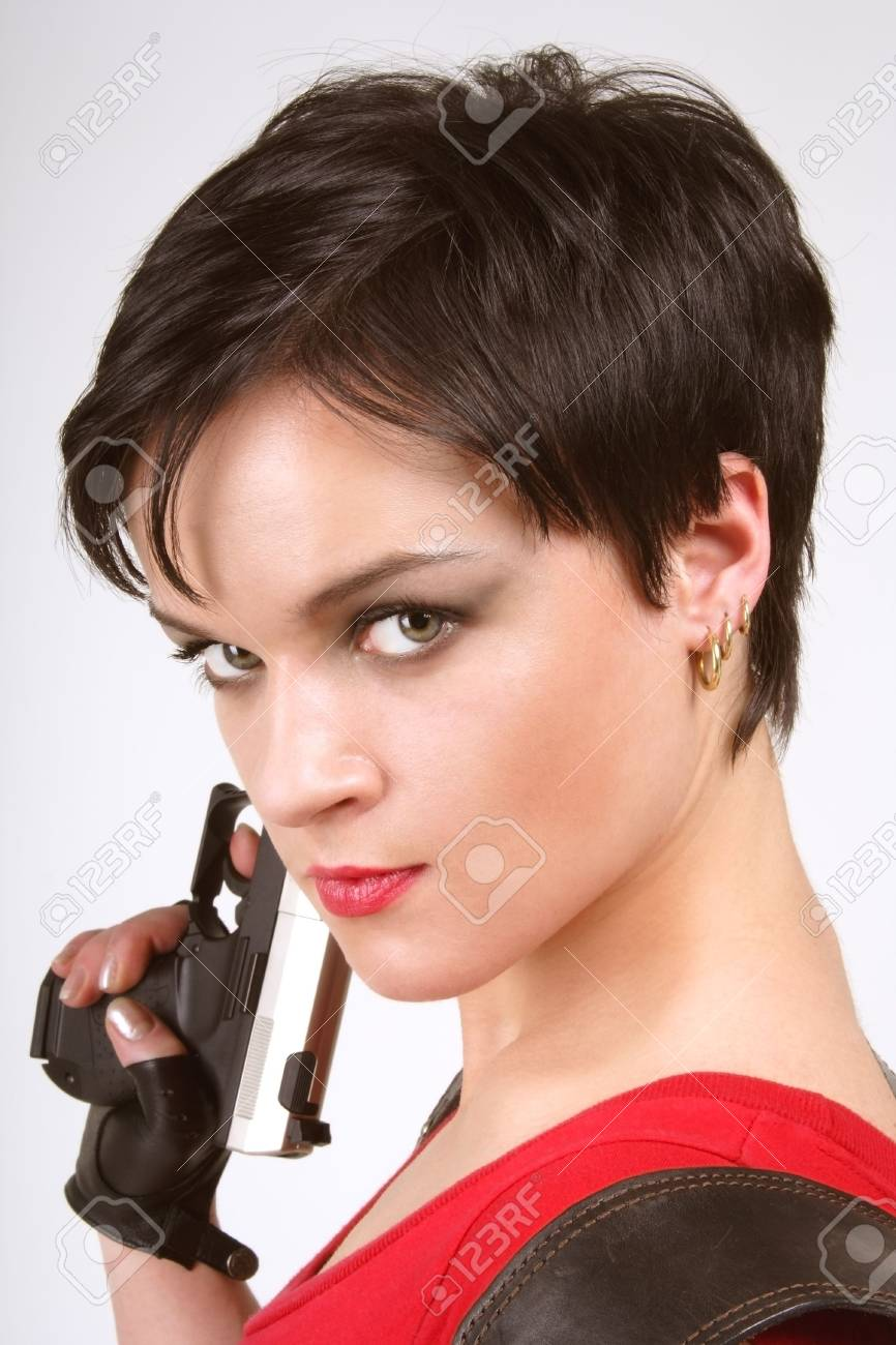 Beautiful dark-haired girl in leather gloves with pistol and pistol holster Stock Photo - 915207