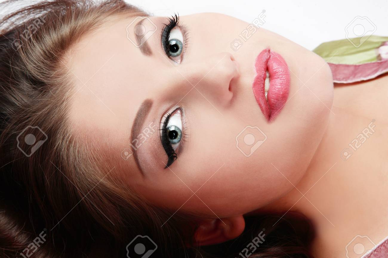 Close-up portrait of beautiful girl with trendy makeup lying in white background Stock Photo - 3085809