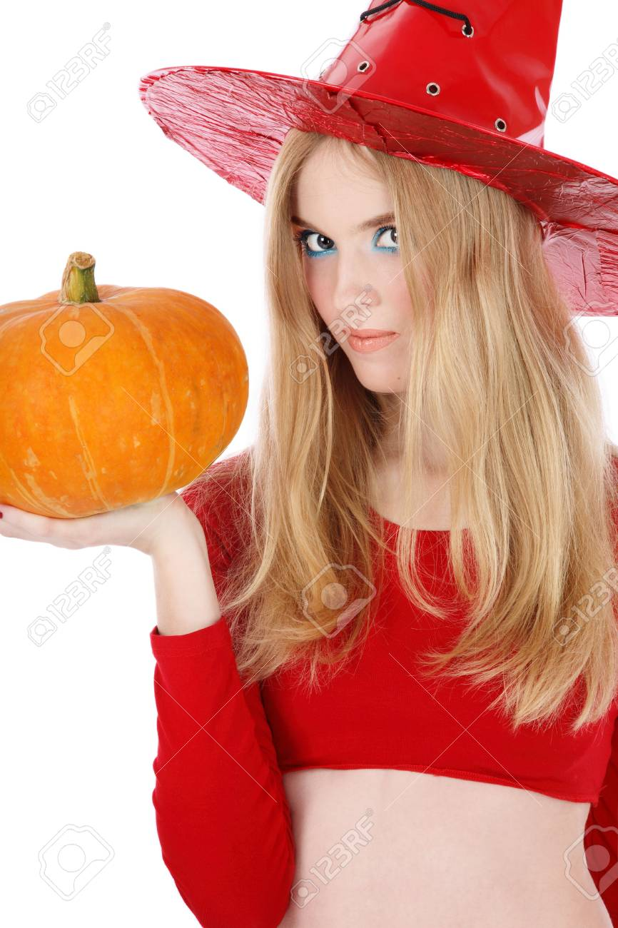 Portrait of pretty blond girl in costume of Halloween witch with pumpkin in hand Stock Photo - 3692760