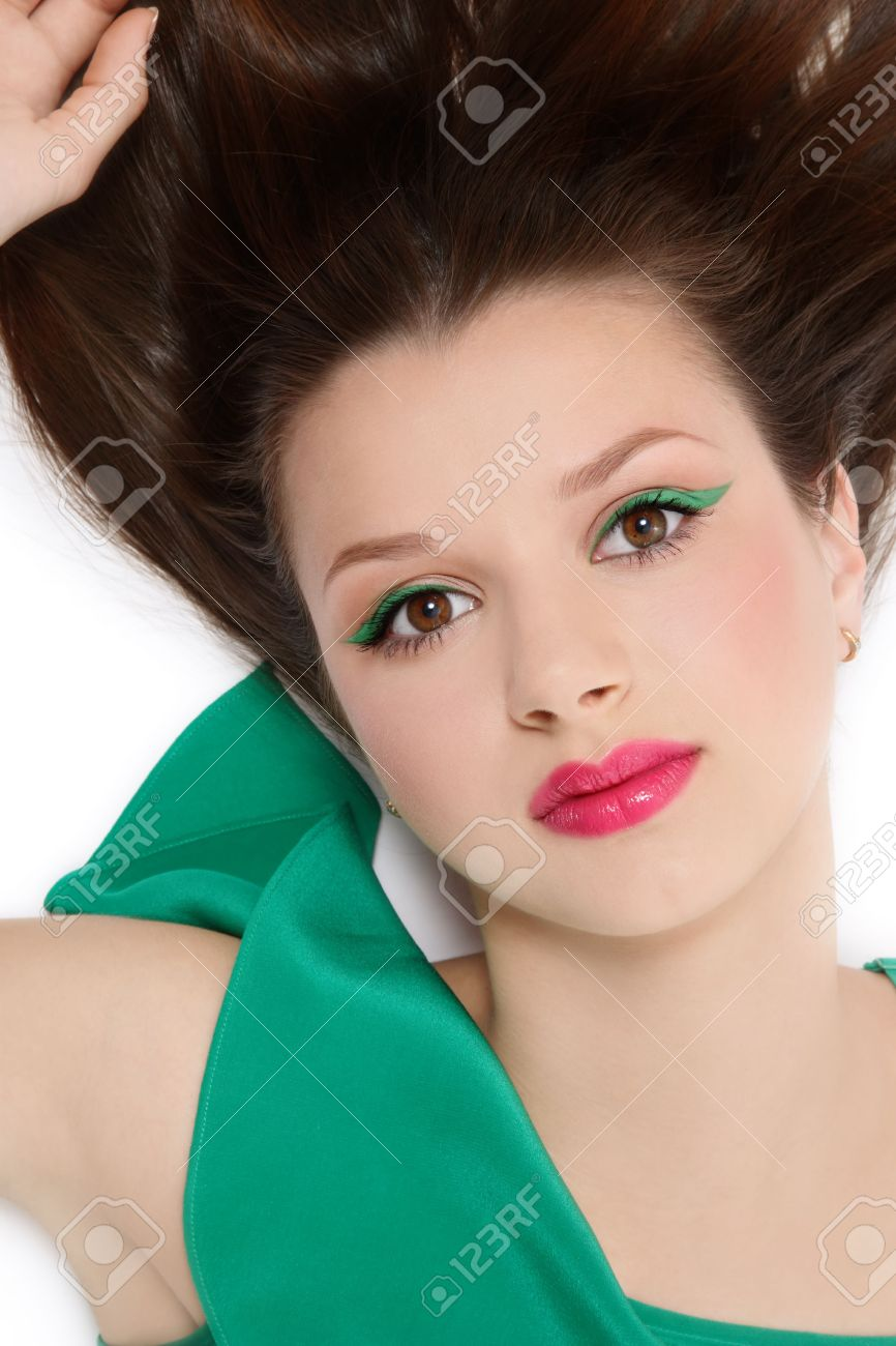 White dress and makeup - Beautiful Young Girl In Green Dress With Fresh Sexy Makeup Lying In White Background Stock Photo