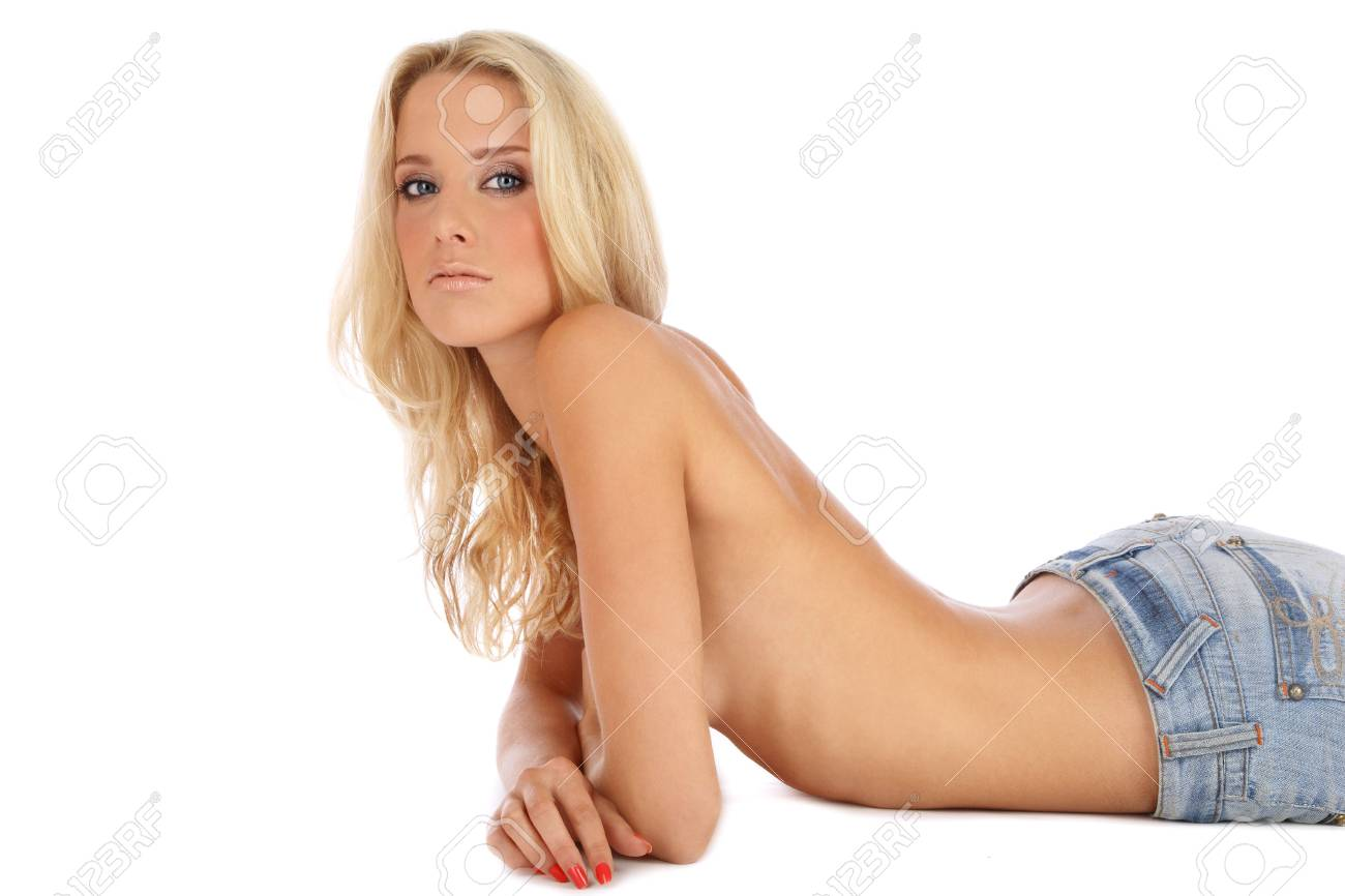 Beautiful slim tanned sexy blonde in blue jeans lying on white background Stock Photo - 5518653