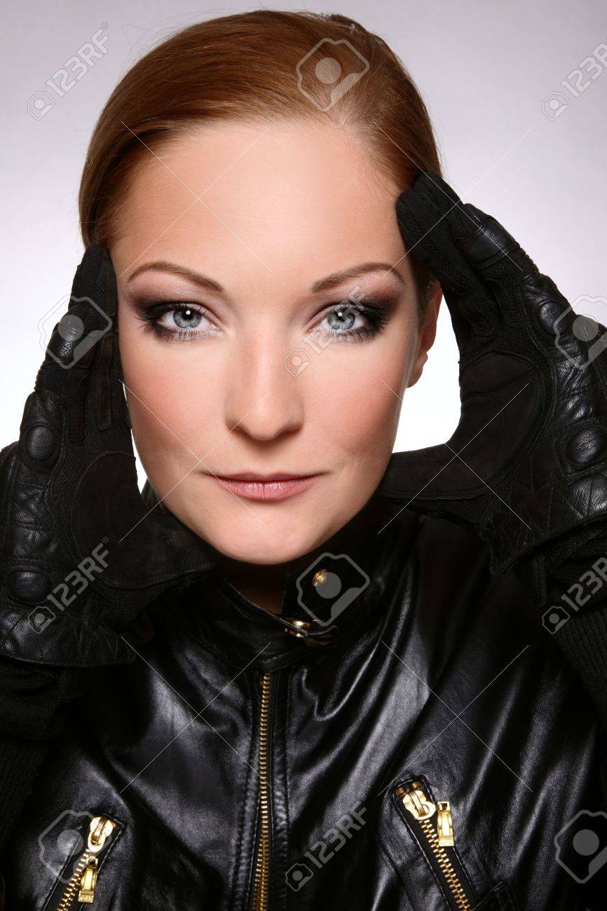 Black leather gloves female - Portrait Of Beautiful Woman With Stylish Makeup In Black Leather Biker Jacket And Gloves Stock Photo
