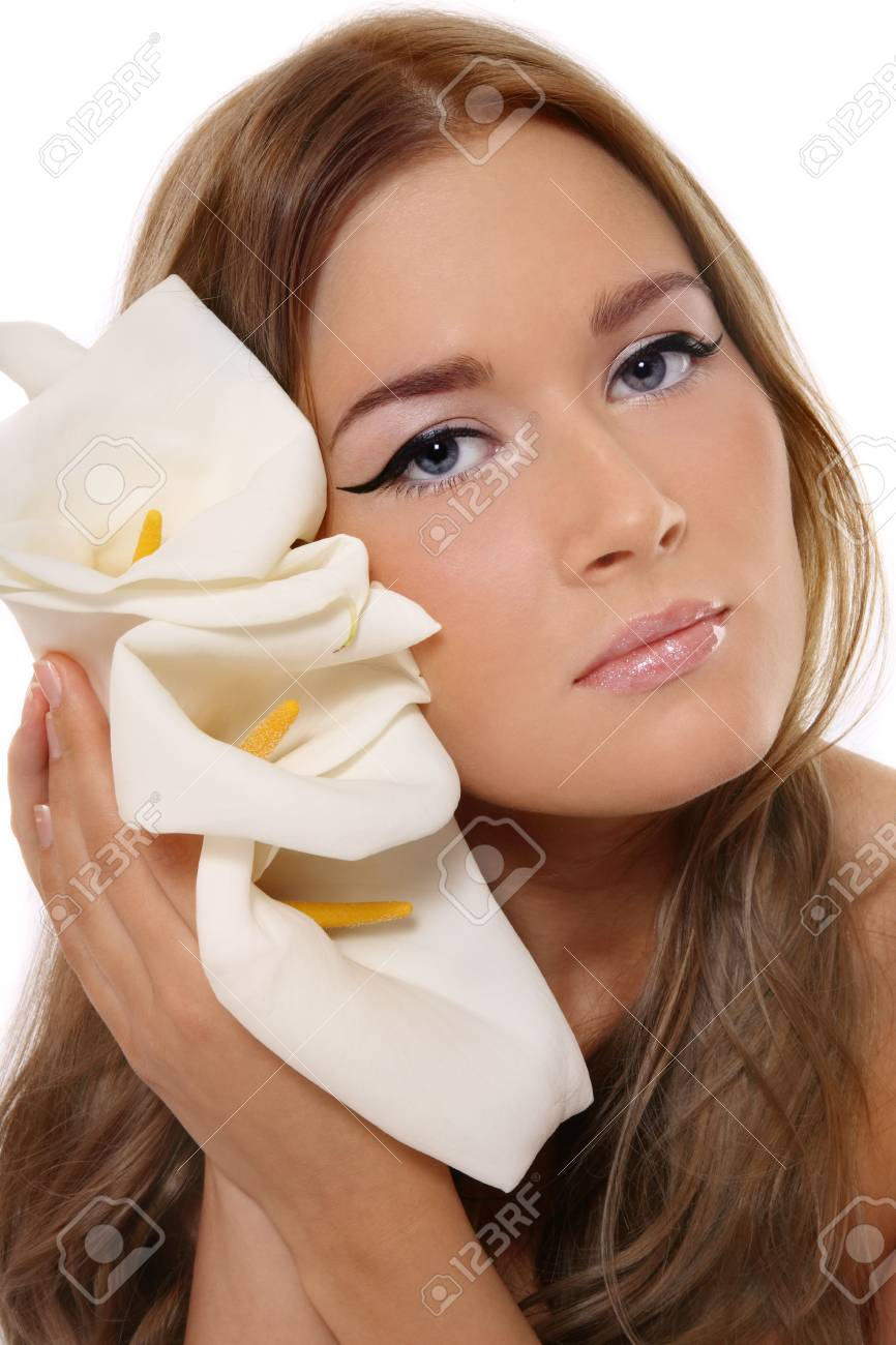 Beautiful blond tanned girl with trendy makeup holding white flowers Stock Photo - 5662370