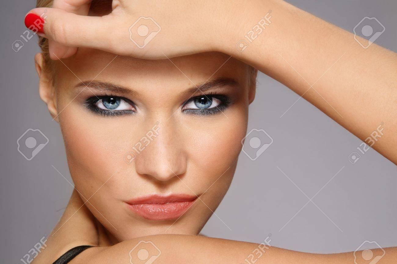 Close-up portrait of beautiful stylish blonde girl with trendy make-up Stock Photo - 6108776