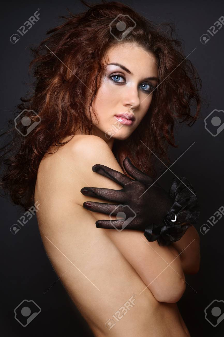 Beautiful sexy girl with curly hair and trendy makeup Stock Photo - 7170471