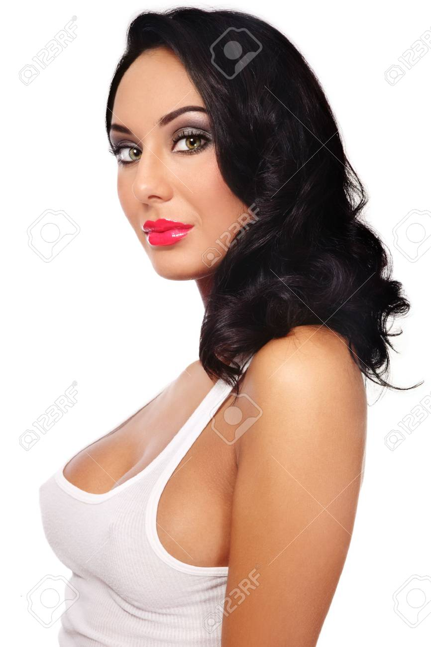 Beautiful tanned sexy brunette with curly hair and stylish make-up on white background Stock Photo - 7956532