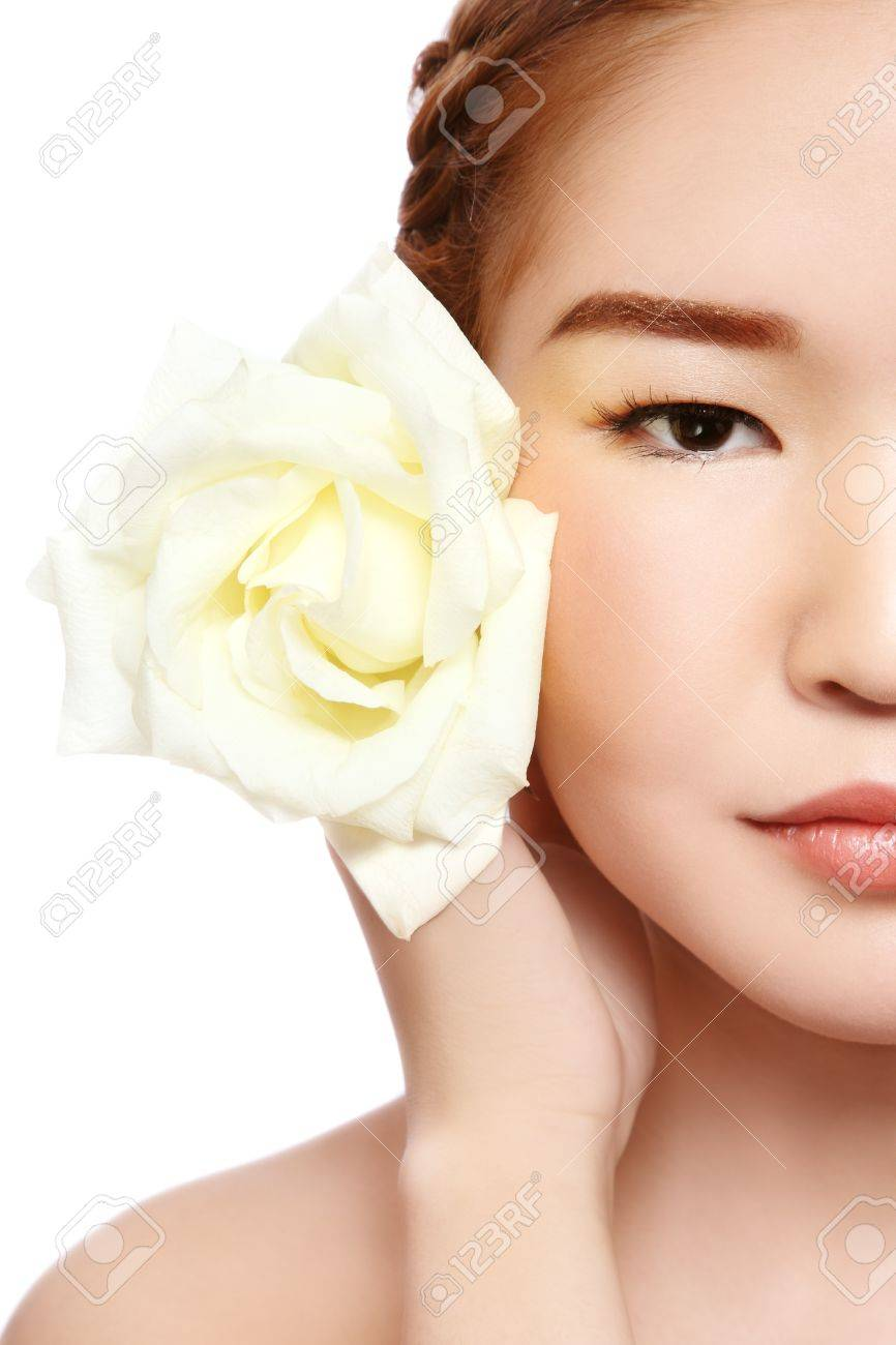 Close-up portrait of young beautiful asian girl with rose on white background Stock Photo - 9101979