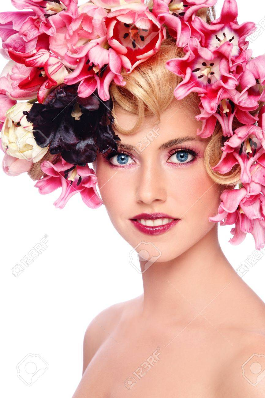 Portrait of young beautiful smiling girl with stylish make-up and colorful flowers on her hair Stock Photo - 9646595