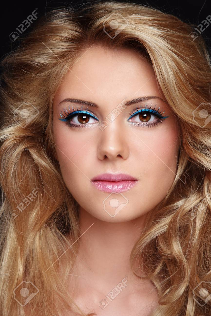 Portrait of young beautiful woman with stylish make-up and long curly fair hair Stock Photo - 10882790