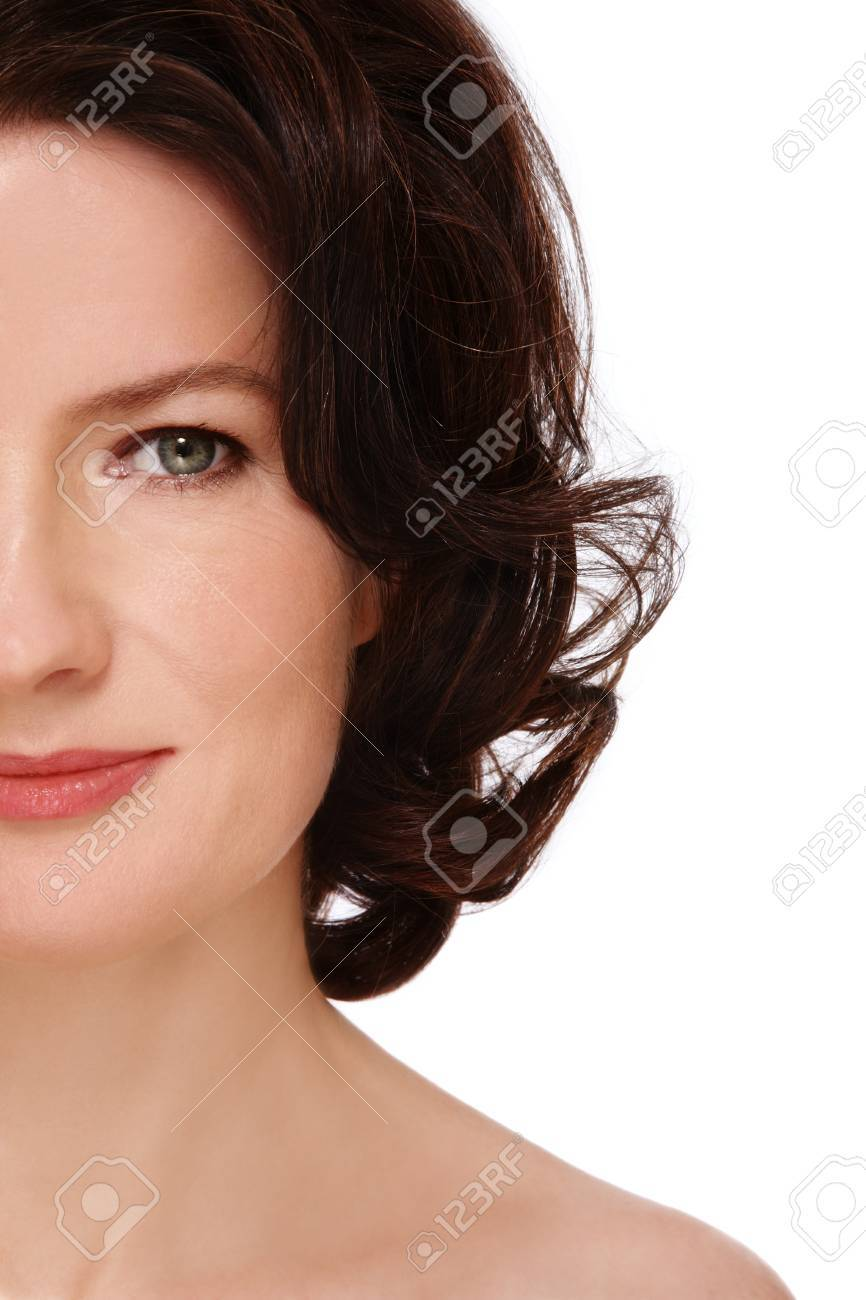 Close-up shot of attractive groomed healthy middle-aged woman on white background Stock Photo - 11082720