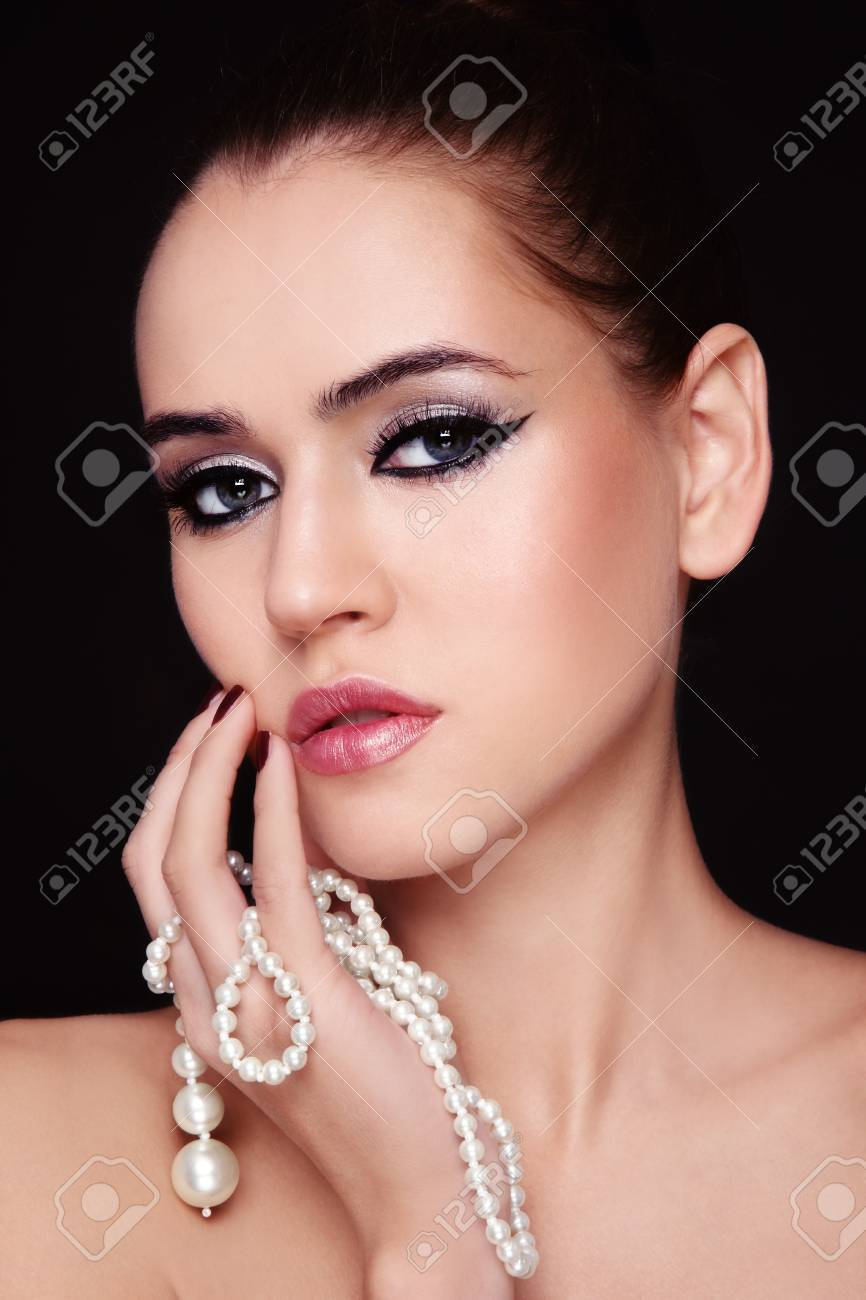 Portrait of young beautiful woman with stylish make-up and pearl  in hand Stock Photo - 11082721