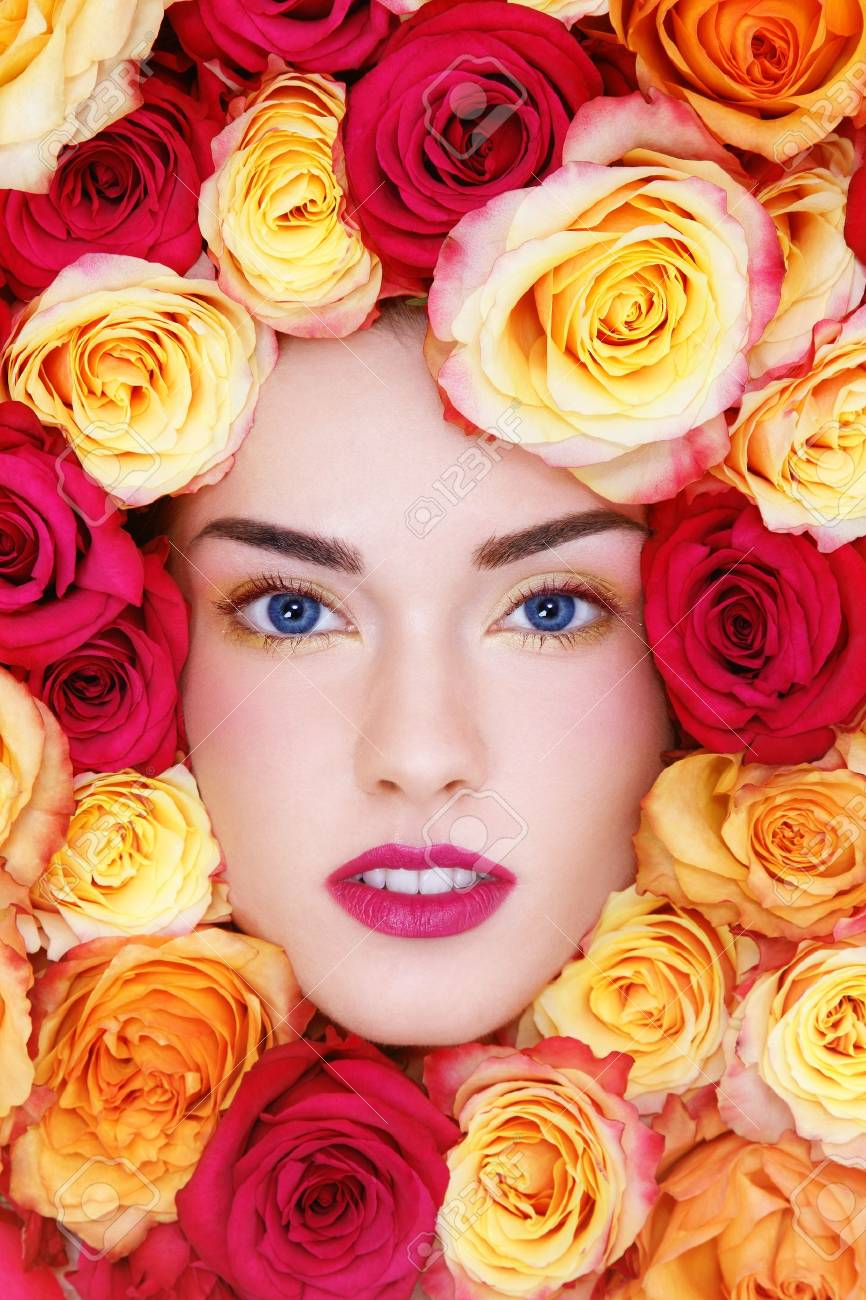 Portrait of young beautiful woman with stylish make-up and colorful roses around her face Stock Photo - 13425976