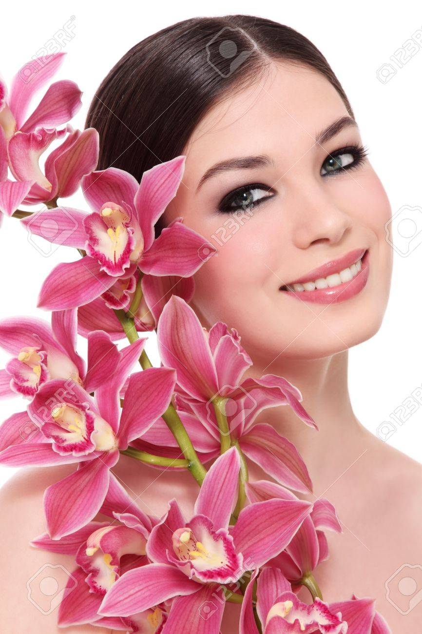 Young beautiful happy smiling girl with orchid on white background Stock Photo - 13589563