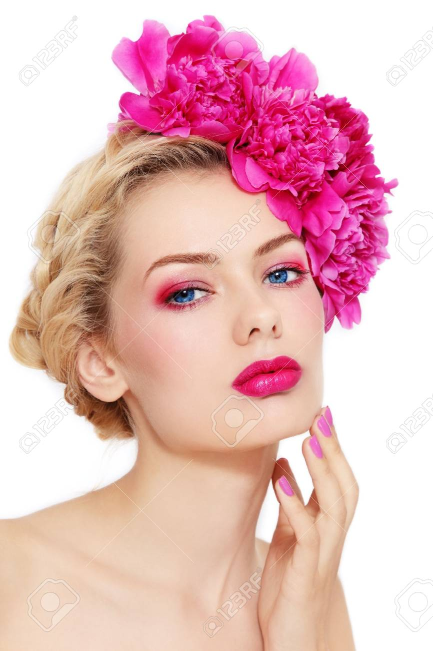 Young beautiful healthy blond girl with pink flowers in her hair on white background Stock Photo - 14496449