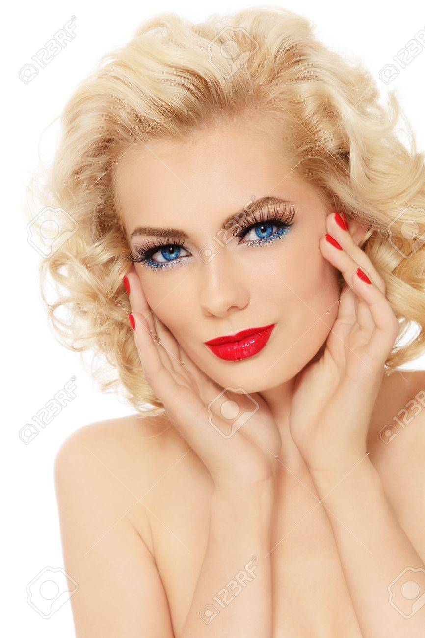 Young beautiful sexy blonde with stylish make-up and hairdo touching her face, on white background Stock Photo - 15032567