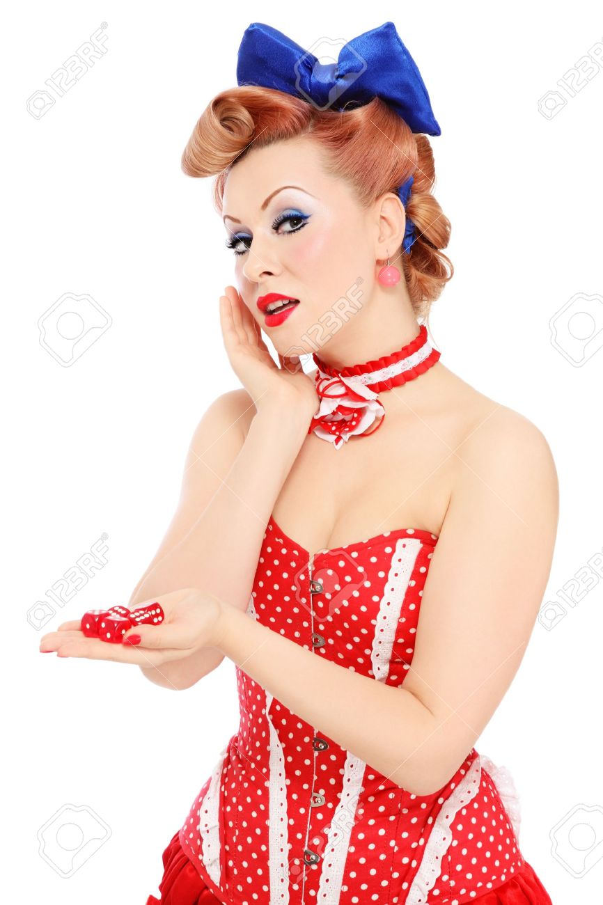 Young beautiful promo pin-up girl in vintage polka dot corset with red dice in hand over white background Stock Photo - 15278779