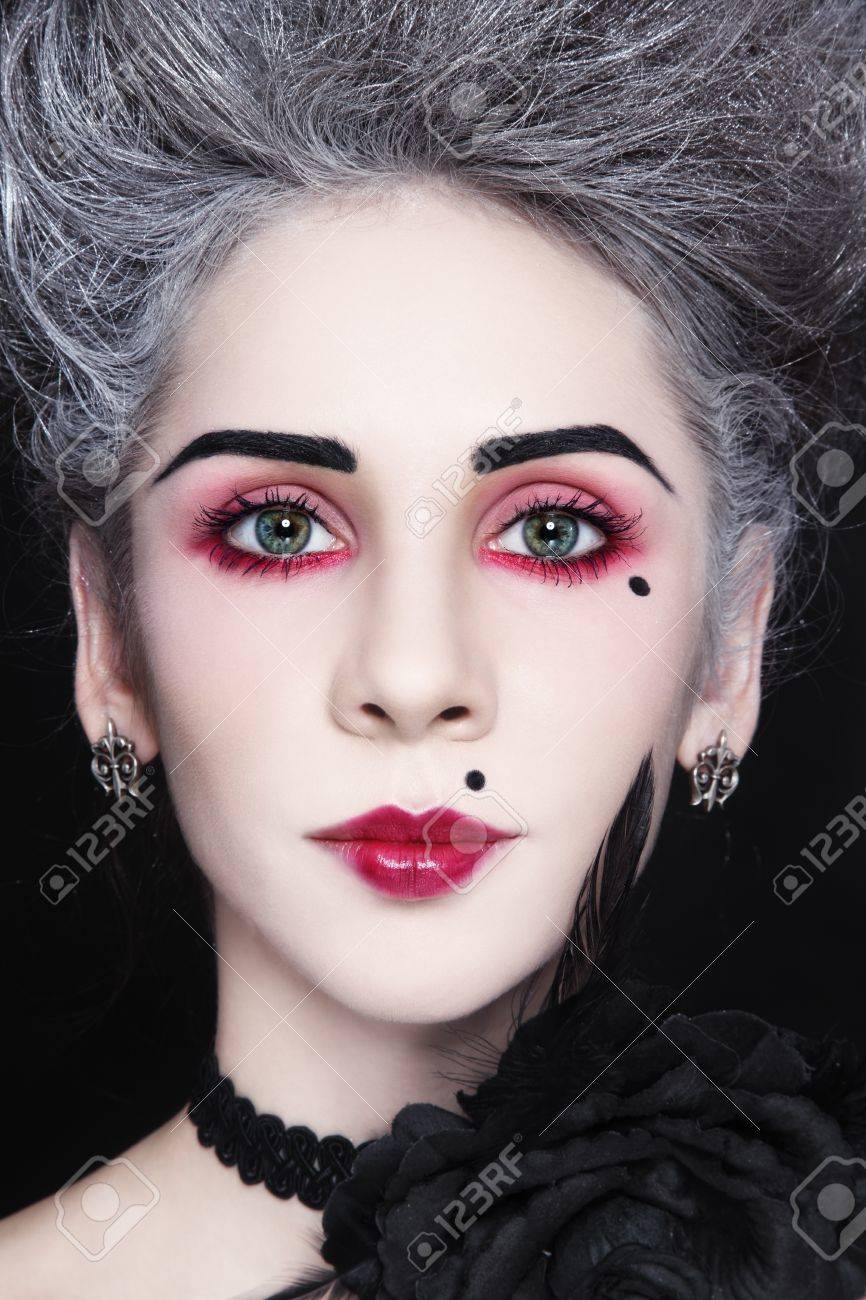 Close-up portrait of young beautiful woman with vintage hairdo and make-up Stock Photo - 17130050