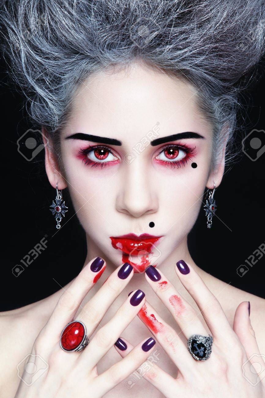 Portrait of young beautiful stylish gothic woman with vintage hairdo and bloody mouth Stock Photo - 17478132