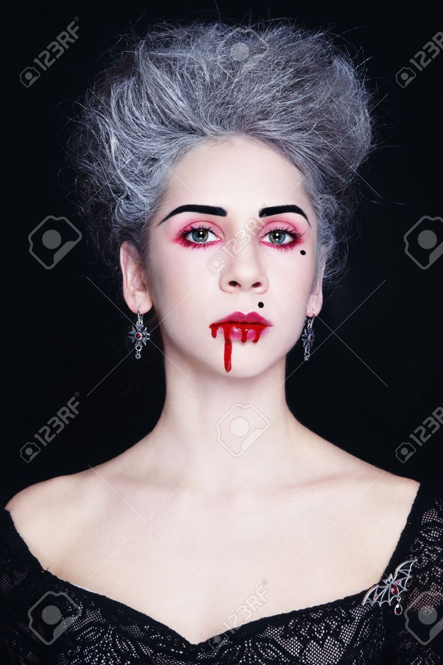 Young beautiful stylish gothic woman with vintage hairdo and bloody mouth Stock Photo - 17478153