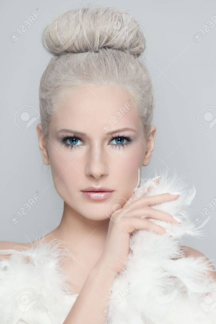 Portrait of young beautiful woman with powdered vintage hairdo and white feather boa Stock Photo - 19550241