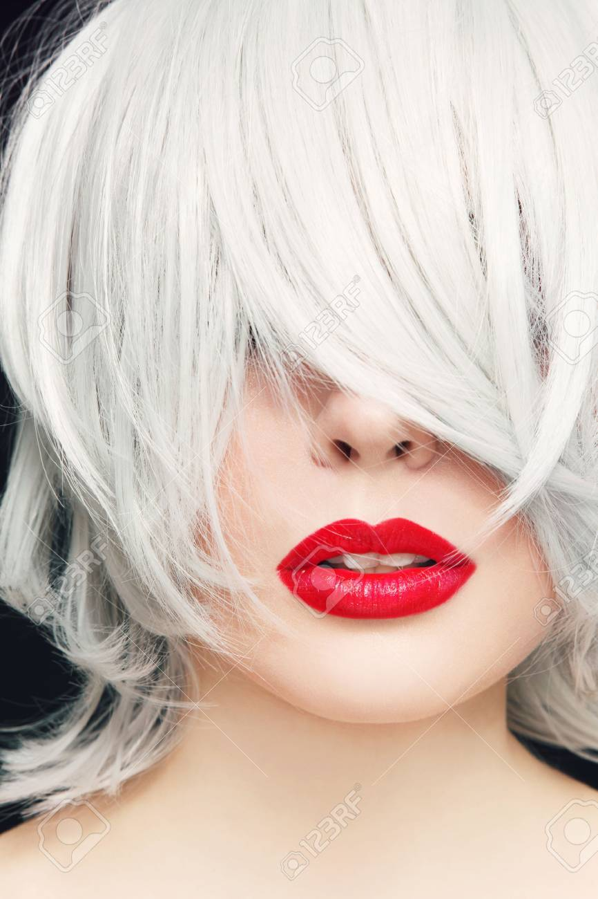 Close,up portrait of young woman with red lipstick and manga..