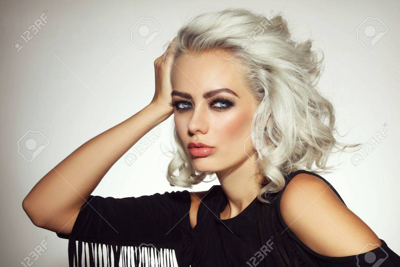 Vintage style portrait of young beautiful platinum blond woman with smoky eyes make-up - 79027349