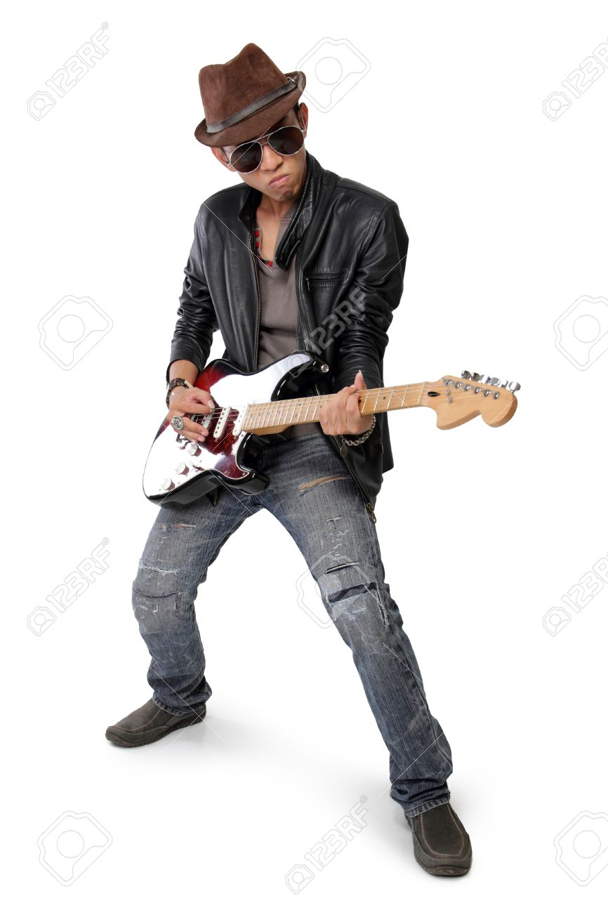 Cool Pose Of A Young Man Playing Electric Guitar Isolated On White Background Stock Photo
