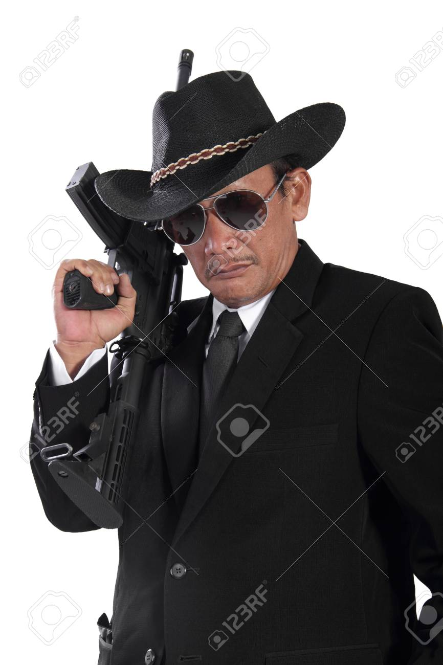 portrait of old gangster holding a gun isolated on white background