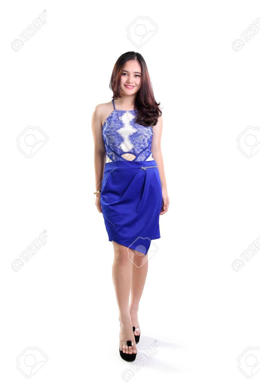 beautiful smiling asian female fashion model walking in a trendy