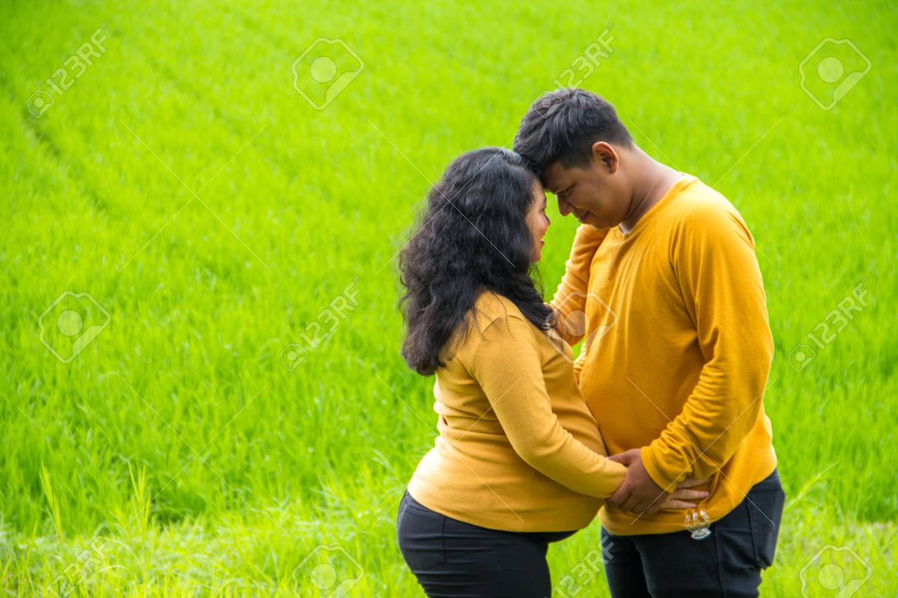 Romantic Asian Husband And Wife During Pregnancy Resting Forehead Stock Photo Picture And Royalty Free Image Image 117542669