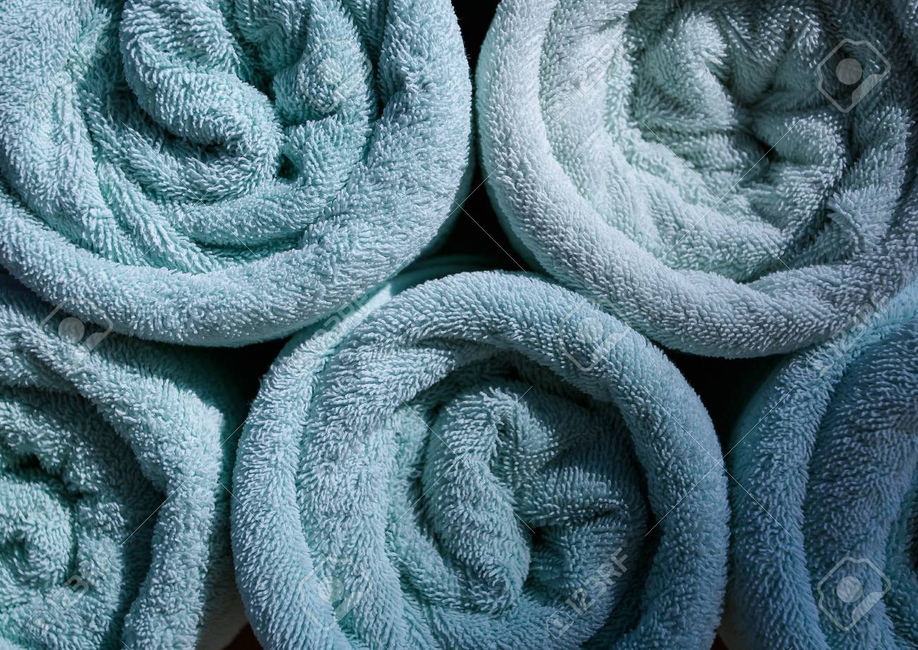 Blue Rolled Towels In Hotel Near Swimming Pool Stock Photo, Picture ...