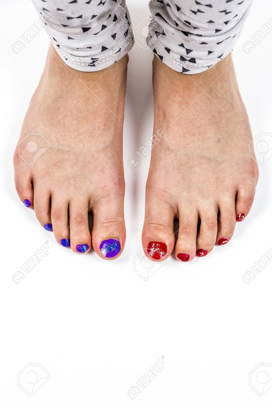 young girls feet, toes with nail polish. stock photo, picture and