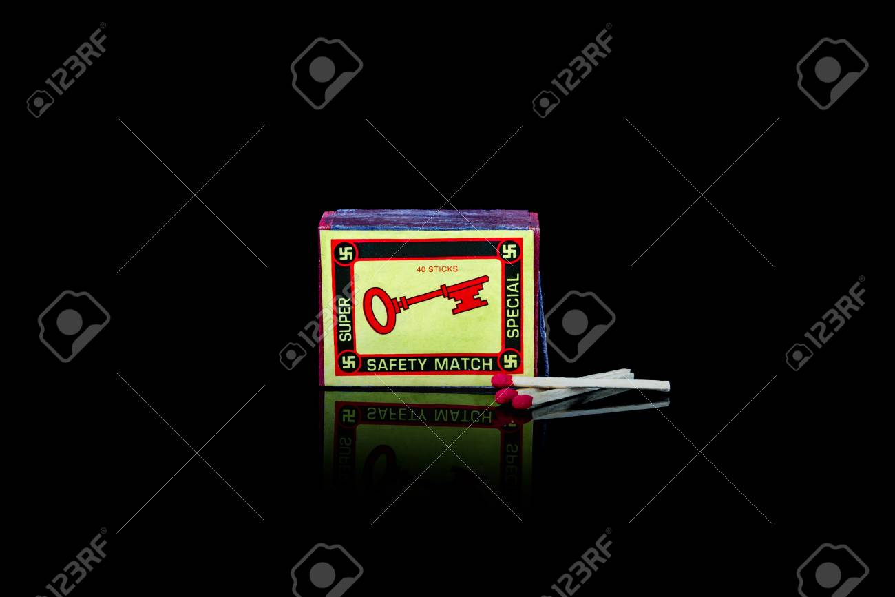 A vintage match box with a key  on the front. Isolated studio shot on black background. Stock Photo - 90494538