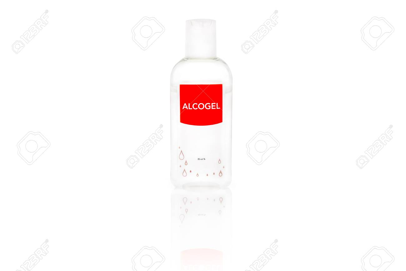 Isolated alcogel hand disinfectant in a small plastic bottle with red label, studio shot on white background. Stock Photo - 90494541
