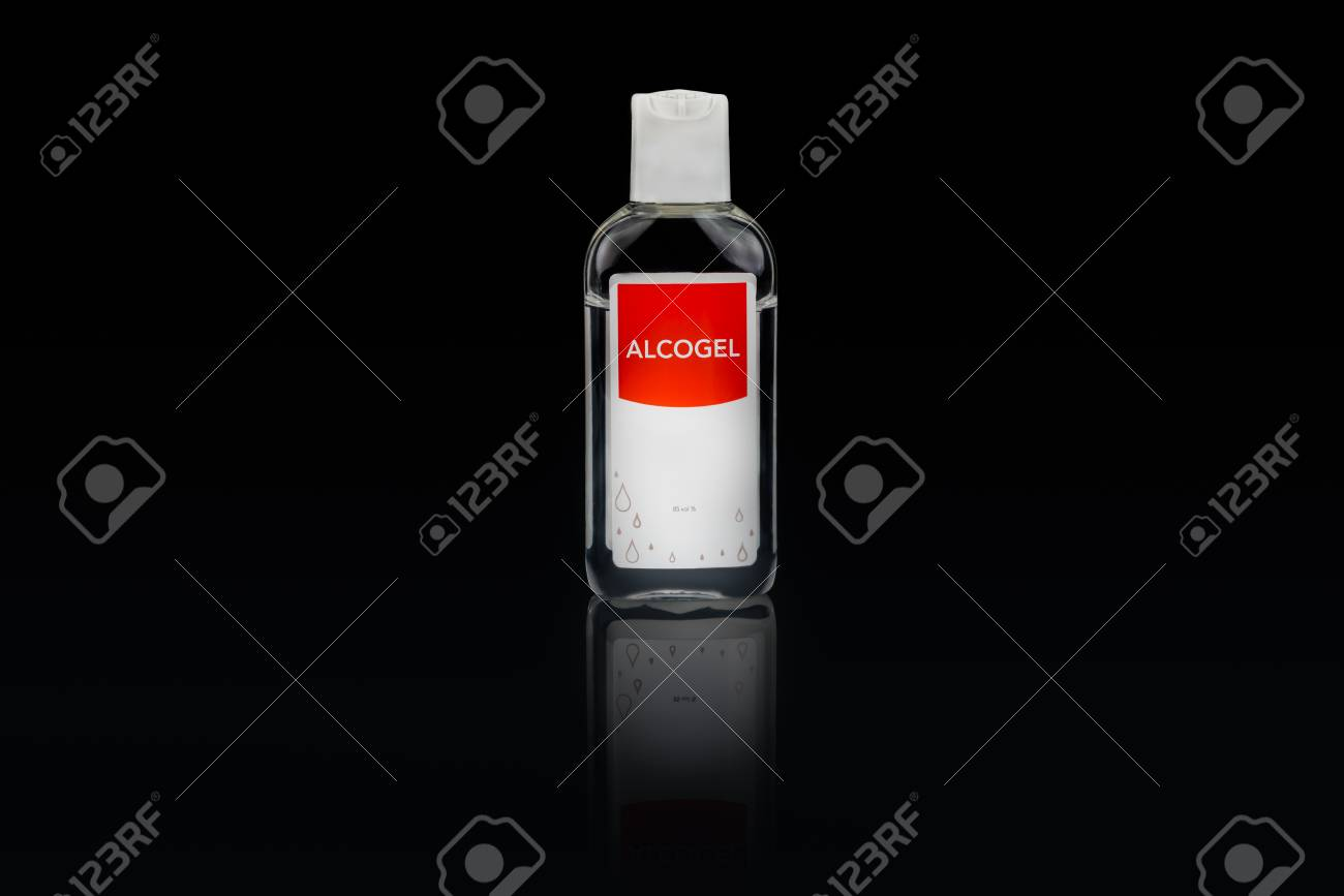 Isolated alcogel hand disinfectant in a small plastic bottle with red label, studio shot on black background. Stock Photo - 90494543