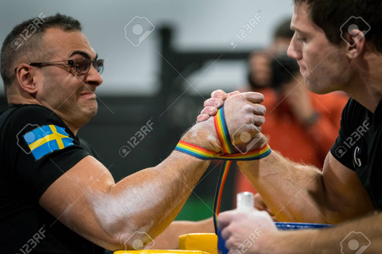 STOCKHOLM, SWEDEN - JANUARY 13, 2018: Profile view of a Swedish and Norwegian male arm wrestler in a match at the event Arm Battle of Sweden outside of Stockholm January 13, 2018. Stock Photo - 94169875