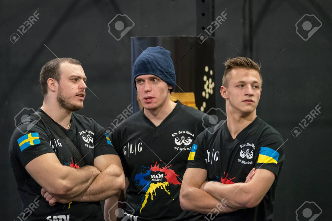 STOCKHOLM, SWEDEN - JANUARY 13, 2018: Portrait of three male arm wrestlers from Sweden and Ukraine taking a brake during the event Arm Battle of Sweden outside of Stockholm January 13, 2018. Stock Photo - 94169878