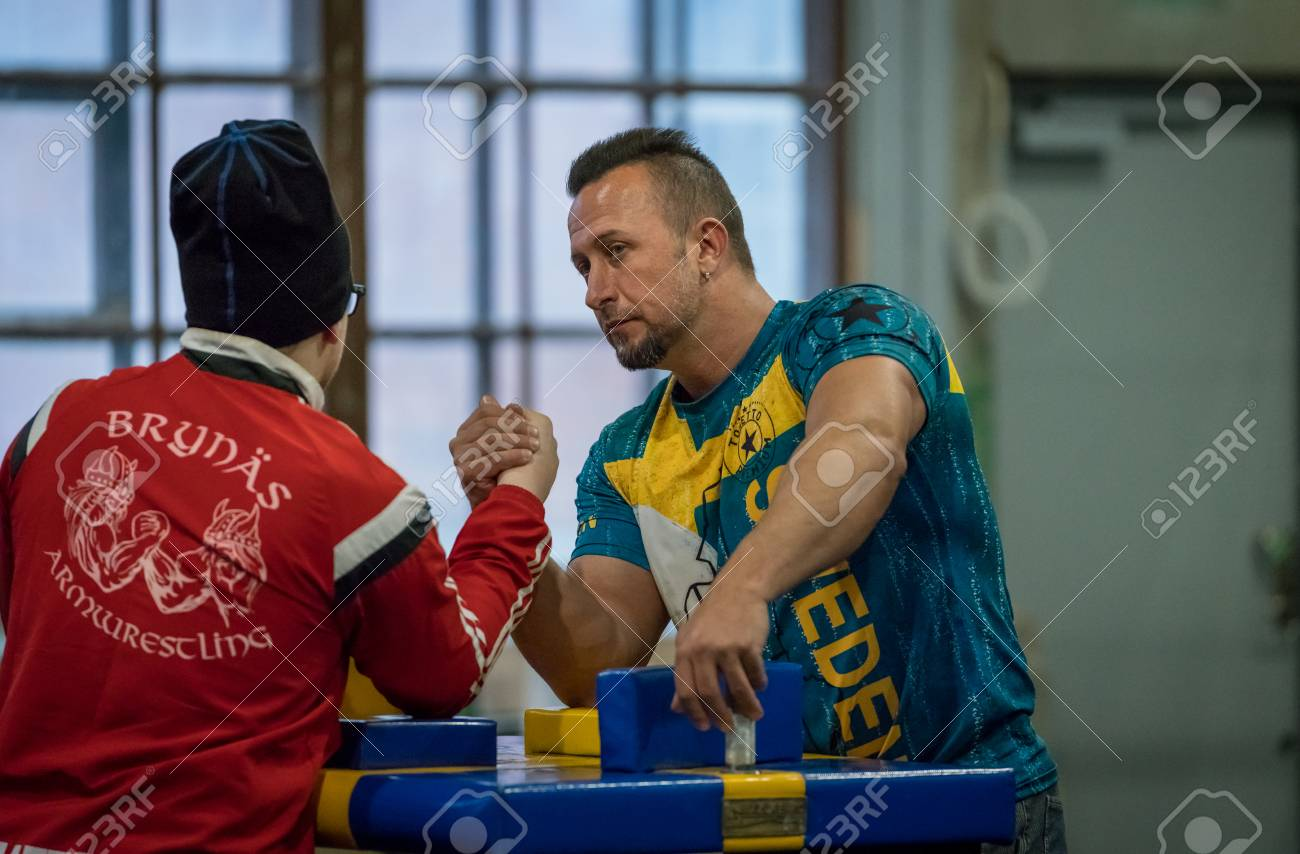 STOCKHOLM, SWEDEN - JANUARY 13, 2018: Two Swedish male arm wrestlers training in a friendly match during the event Arm Battle of Sweden outside of Sockholm January 13, 2018. Stock Photo - 94169886
