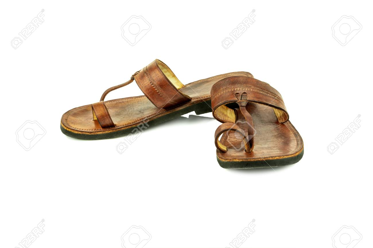 c3e0b453a11e Front view of a pair of brown traditional indian leather sandals isolated  on white background.