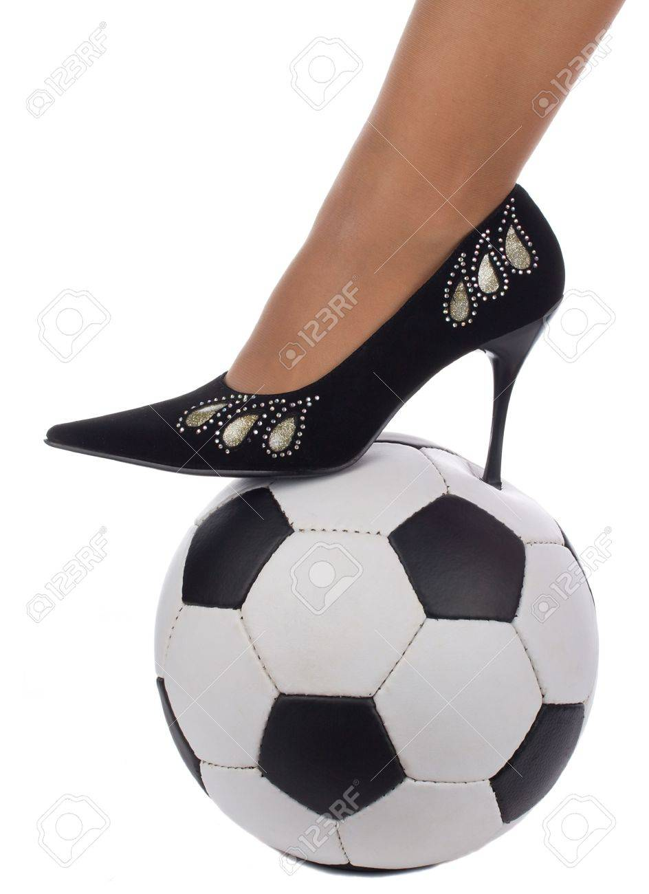woman foot in high-heeled shoe stand on soccer ball, isolated on white Stock Photo - 3891346