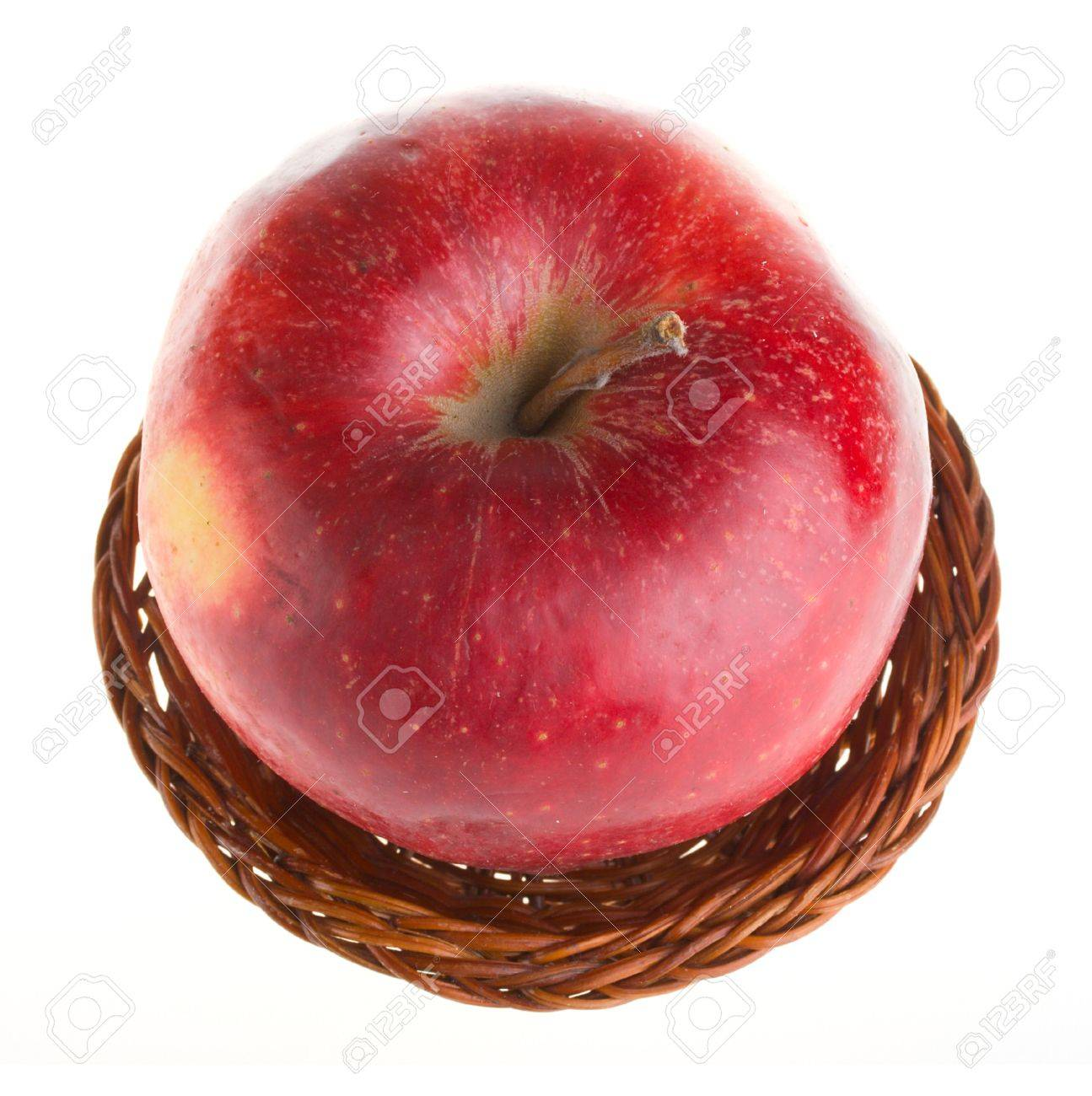 close-up red apple in basket, view from above, isolated on white Stock Photo - 3953503
