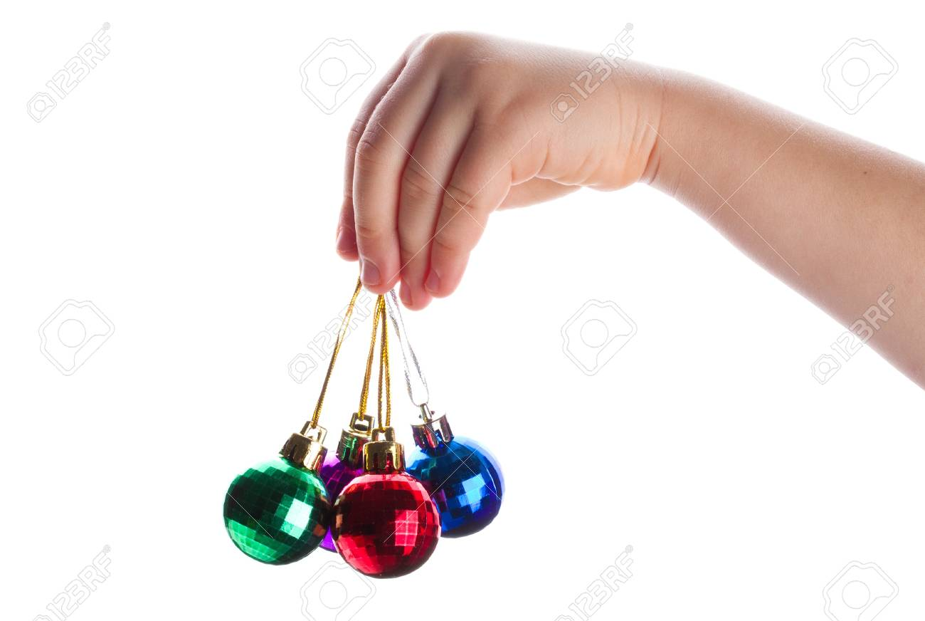 close-up christmas decoration in hand, isolated on white Stock Photo - 10864514