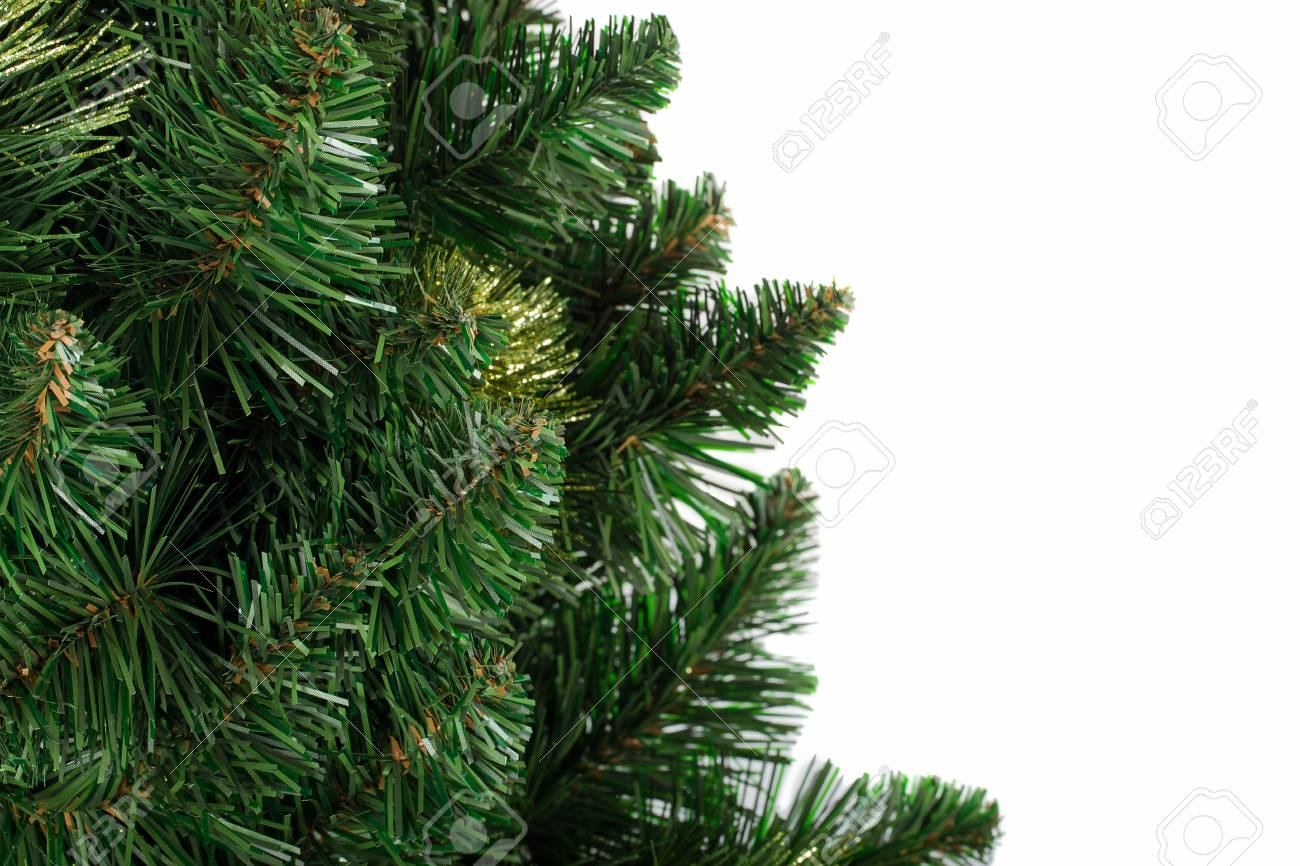 Artificial Christmas Tree Branches.Close Up Artificial Fir Tree Branches Isolated On White