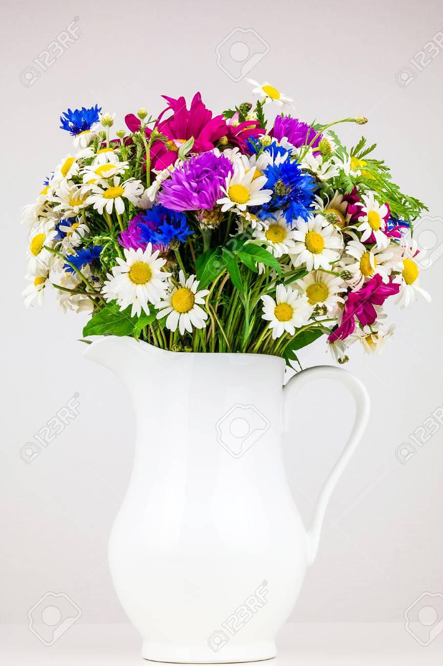 Wildflowers In White Ceramic Jug. Wild Flower Bouquet On White ...