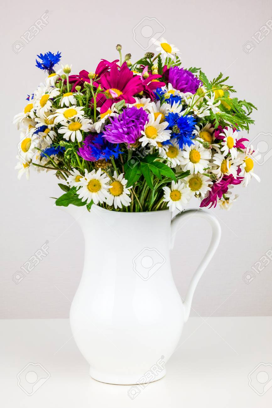 Wildflowers In White Ceramic Jug. Wild Flower Bouquet On White ...