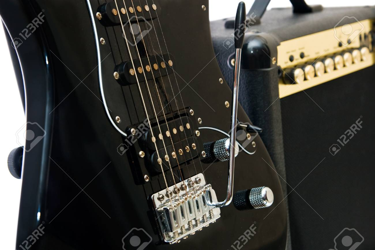Electric guitar and amplifier isolated on a white background Stock Photo - 8245606