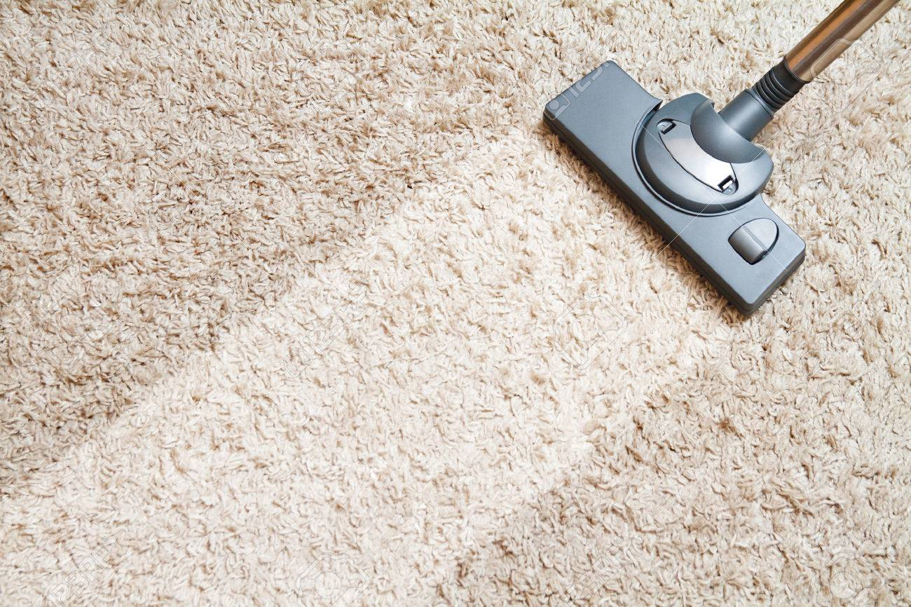 Include The Long Beige Carpet Cleaning With A Vacuum Cleaner Stock Photo