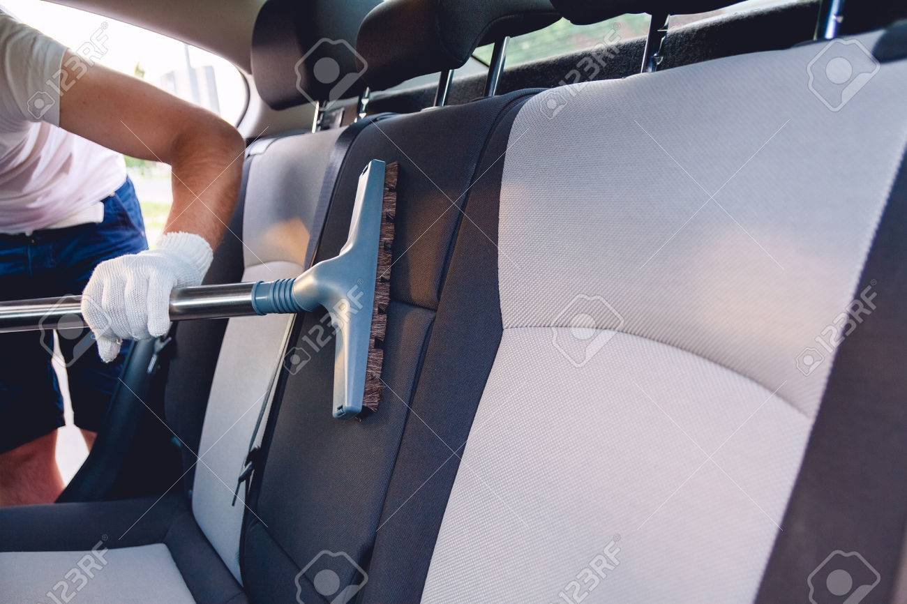 A Man Cleans The Interior Of The Car Vacuum Cleaning Car Seats