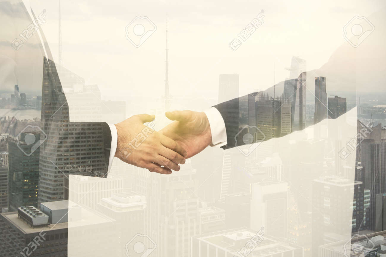 Multi exposure of handshake of two businessmen on city skyscrapers background, collaboration and teamwork concept - 151784105